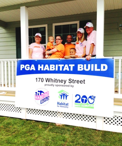 PTWA VP of Community Outreach, Meagan Laird with Cindy and Ted Bishop, PGA of America President, welcoming the family to their new home
